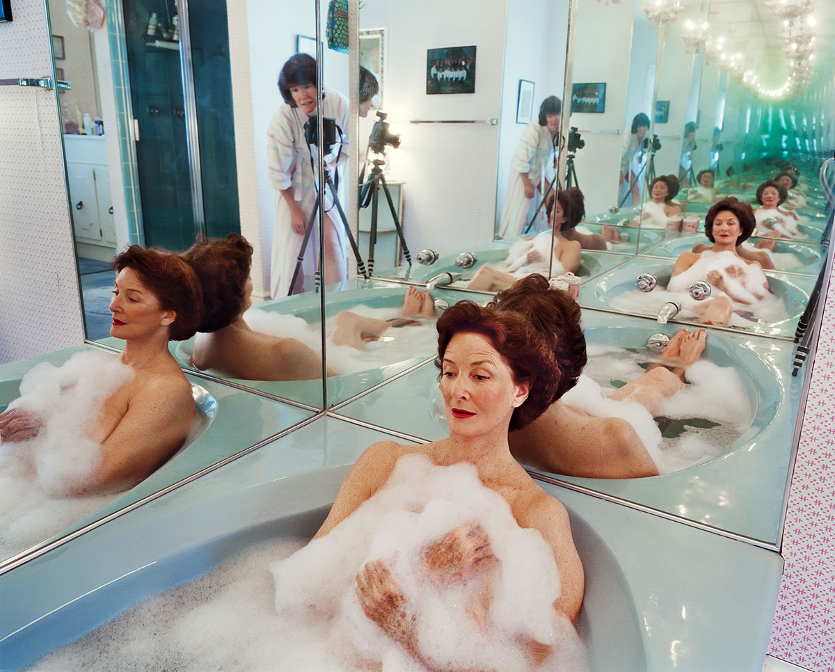 Mother in a bathtub being photographed